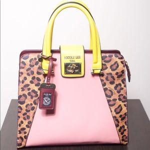 Nicole Lee Multi color purse worn once